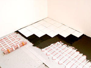 WarmQuest's Heatwave mats are installed under tile for heated floors